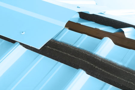 MultiVent10™ with a pre-applied adhesive strip is easily applied to the underside of a metal ridge cap for easy field installation